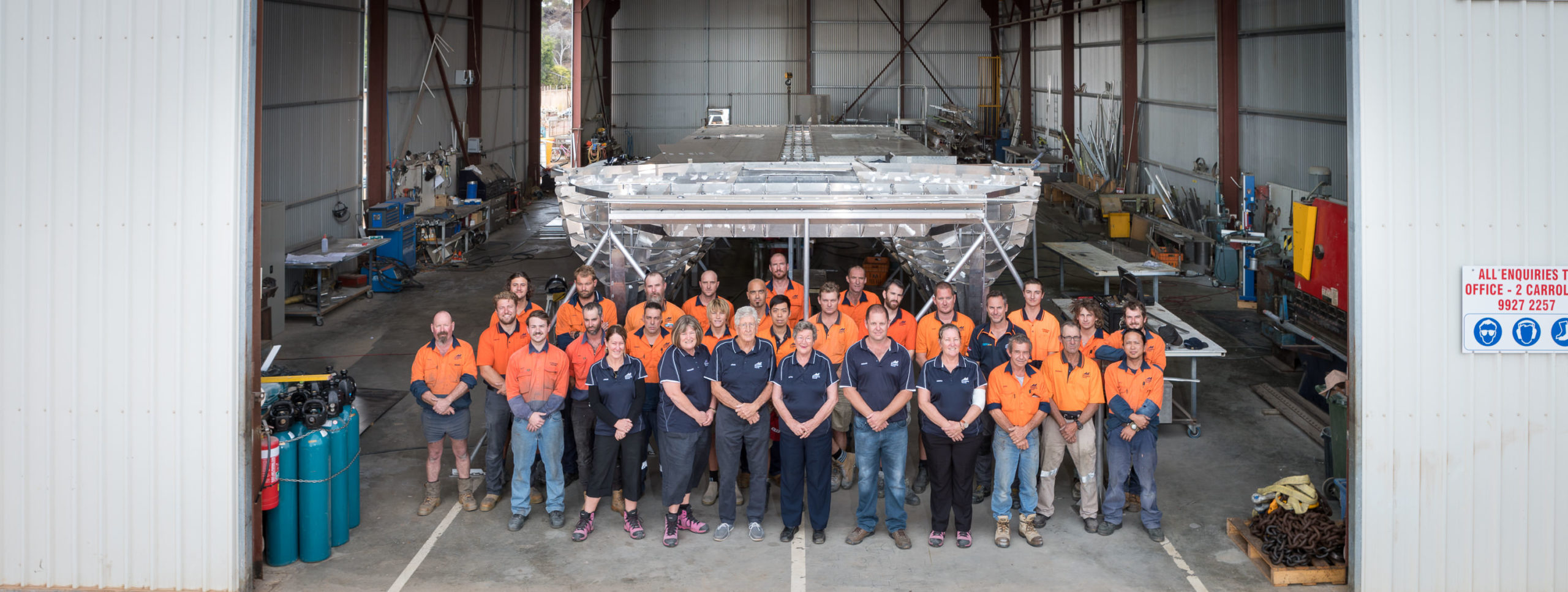 Dongara Marine workforce with shed